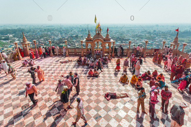 Mathura, Uttar Pradesh, India - February 23, 2010: People at the rooftop of Radha Rani Temple during the Braj Holi festival