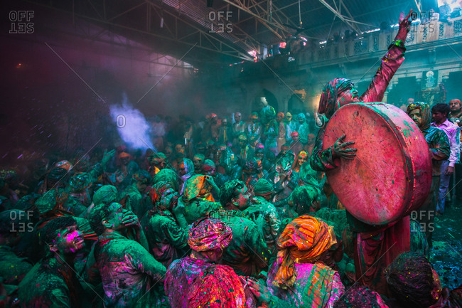 Mathura, Uttar Pradesh, India - February 23, 2010: Man holding a drum at the Braj Holi festival