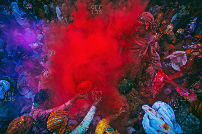 Mathura, Uttar Pradesh, India - February 23, 2010: People covered with red powder paint at the Braj Holi festival