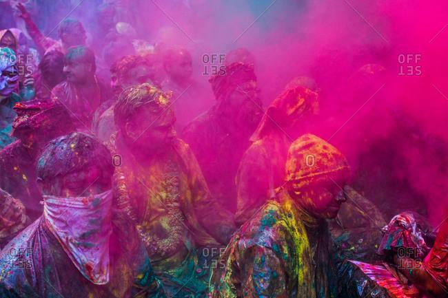 Mathura, Uttar Pradesh, India - February 23, 2010: People covered with pink powder paint at the Braj Holi festival