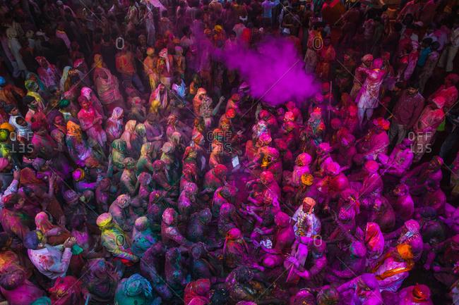 Mathura, Uttar Pradesh, India - February 23, 2010: Crowd at the Braj Holi celebration in Vrindavan