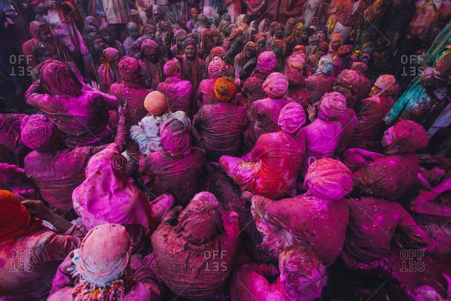 Mathura, Uttar Pradesh, India - February 23, 2010: People at the Braj Holi celebration in Vrindavan