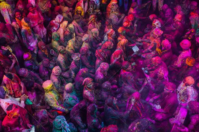 Mathura, Uttar Pradesh, India - February 23, 2010: People drenched in colors at the Braj Holi celebration in Vrindavan