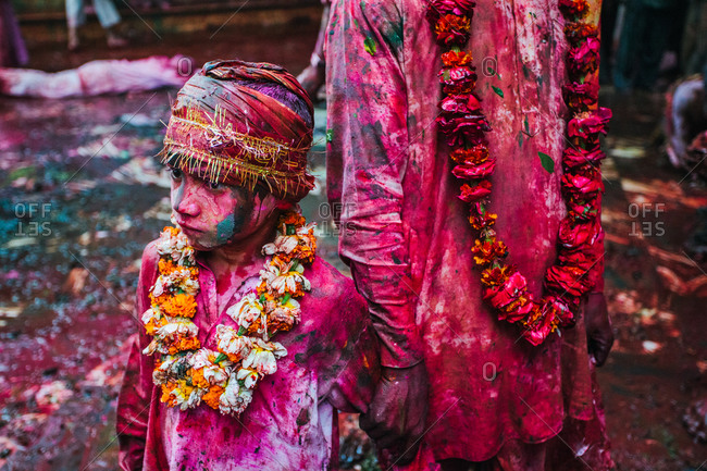 Mathura, Uttar Pradesh, India - February 23, 2010: Young boy with his parent at the Braj Holi festival in Vrindavan