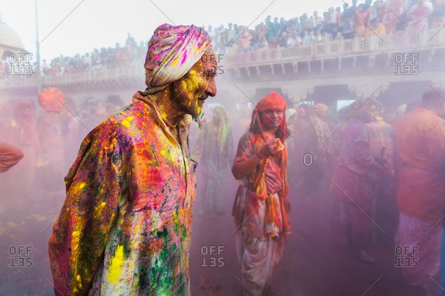 Mathura, Uttar Pradesh, India - February 24, 2010: People celebrating the colorful festival of Holi in Nandgaon village