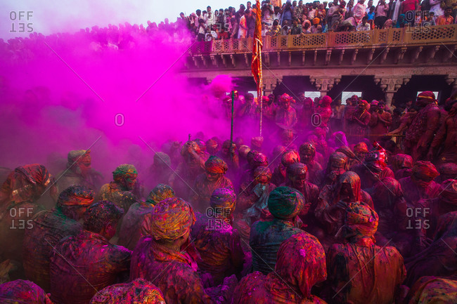Mathura, Uttar Pradesh, India - February 24, 2010: People covered with powder paint at the celebration of Nandgaon Holi
