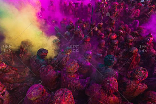 Mathura, Uttar Pradesh, India - February 24, 2010: People drenched in colors at the festival of Nandgaon Holi in Uttar Pradesh, India