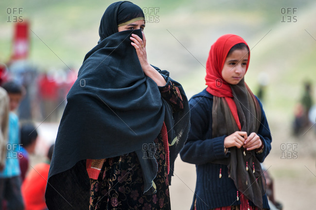 Dras, Jammu and Kashmir, India - July 9, 2011: Portrait of a woman with a young girl