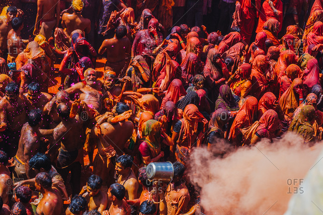Mathura, Uttar Pradesh, India - February 12, 2009: Hindu devotees celebrating at the festival of colors at the Baldev Temple in Dauji