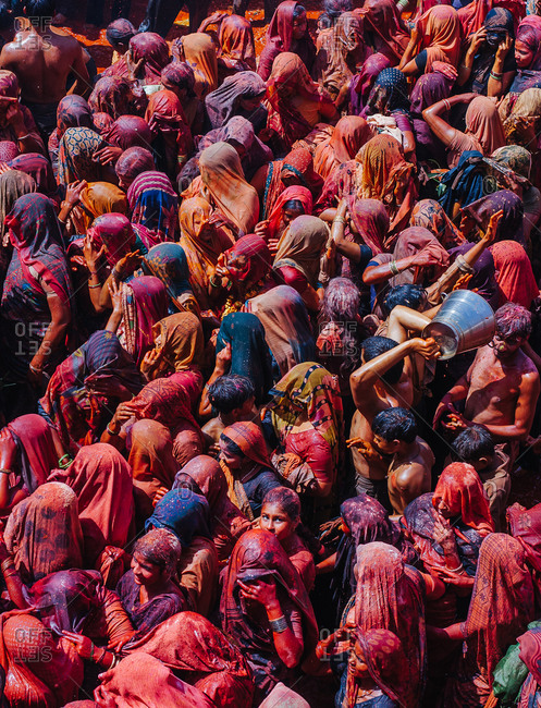 Mathura, Uttar Pradesh, India - February 12, 2009: People drenched in colors celebrating at the festival of colors in Dauji