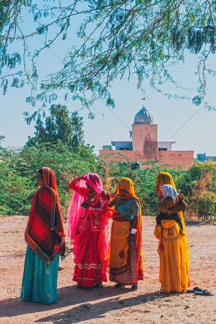 Nagaur, Rajasthan, India - January 1, 2009: Ethnic Indian women looking in the same direction
