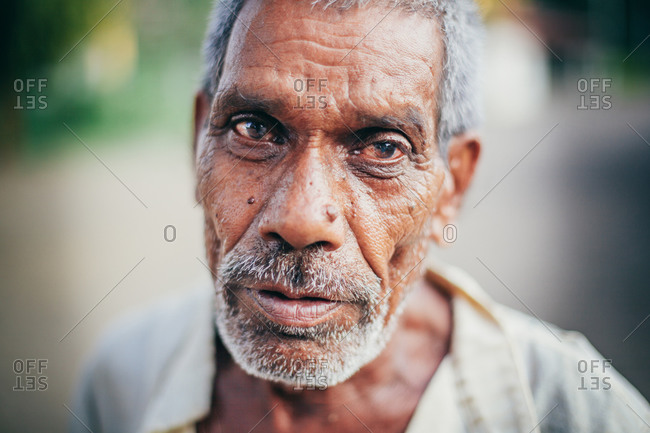 Sewagram, Wardha, Maharasthra, India - September 28, 2012: Portrait of a man at a small town of Sewagram