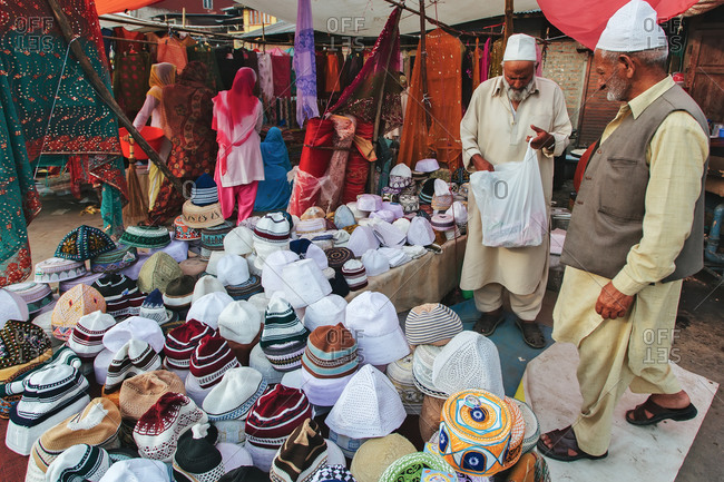 Hazratbal, Srinagar, Jammu & Kashmir, India - July 8, 2011: Vendors selling hats at market
