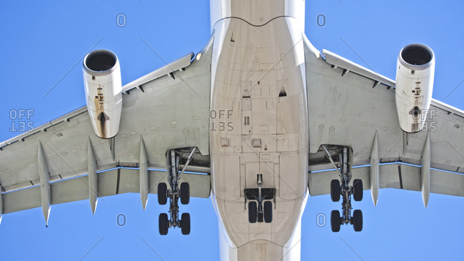 Detail of airplane flying in the sky