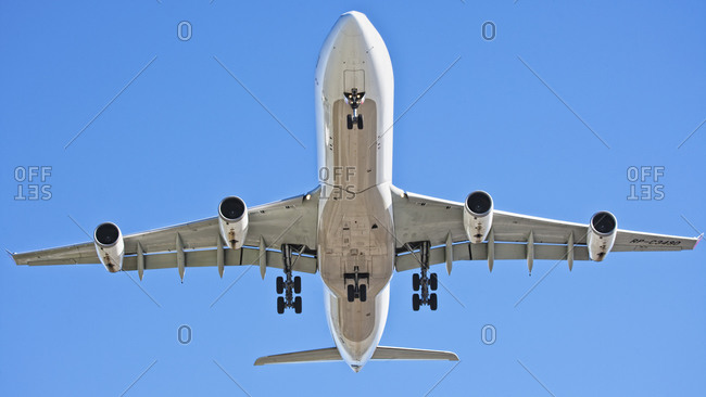 Low angle view of airplane flying in the sky