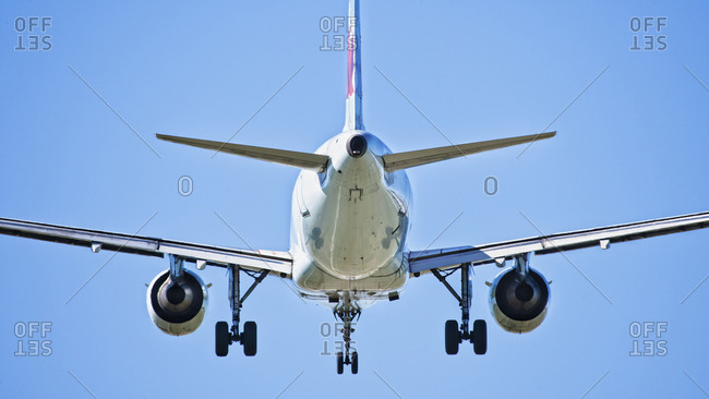 Back view of airplane flying in the sky