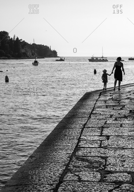 Woman with her daughter walking on a coast in Croatia