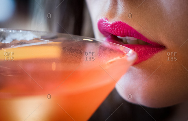Woman drinking a cocktail