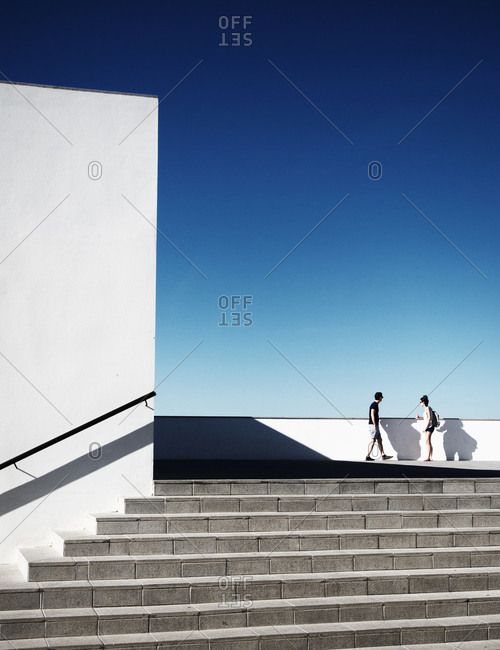 A couple standing on viewpoint, Andalusia, Spain