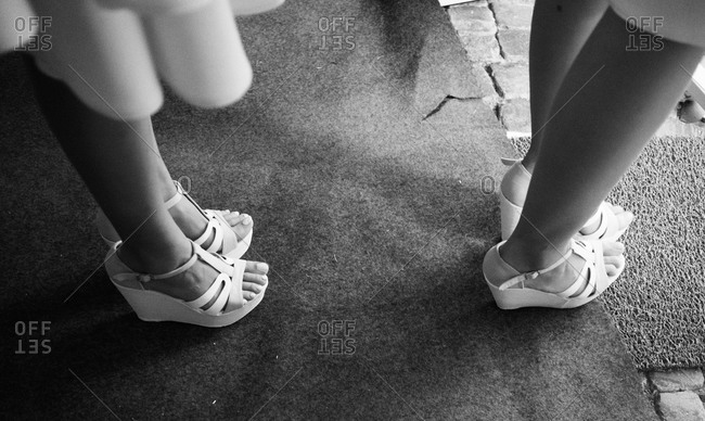 Women standing in high heel sandals
