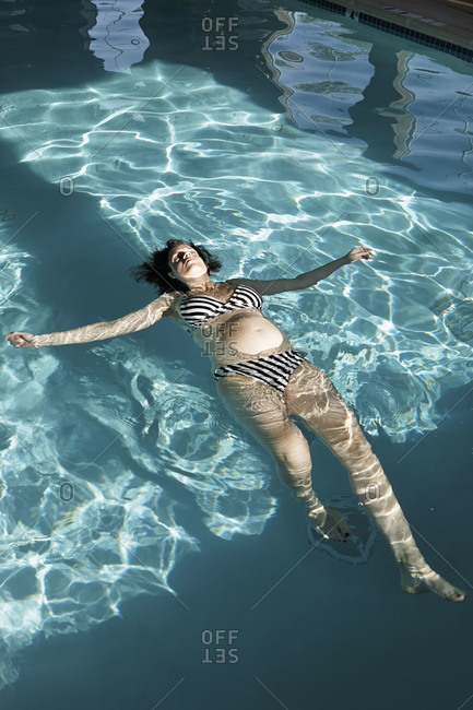 A woman floats in a pool