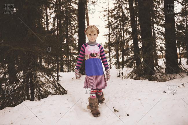 Portrait of girl in patchwork dress outside in winter