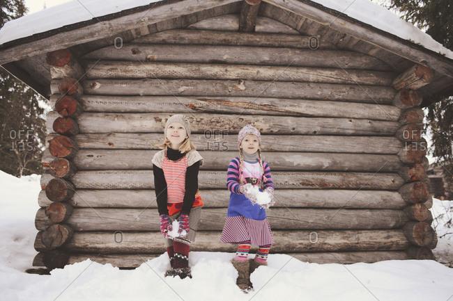 Two girls preparing to throw snowballs