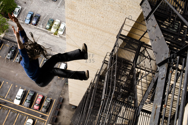 Woman jumping from a fire escape