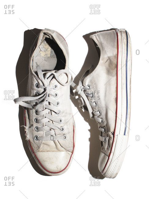 A pair of rubber and canvas sneakers