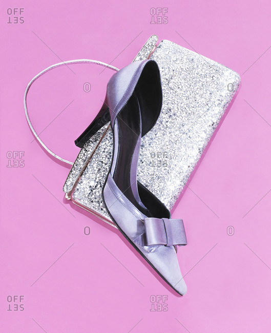 Shoe and purse on pink background