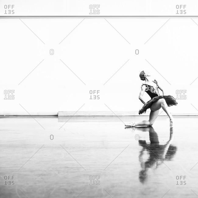 A ballerina poses while rehearsing