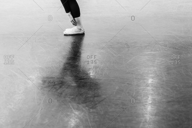 A dancer stretches in the studio