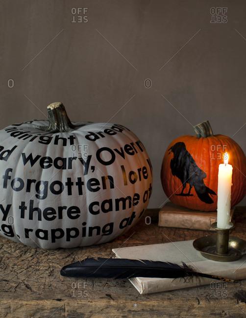 Still life of Halloween pumpkins on rustic wooden table
