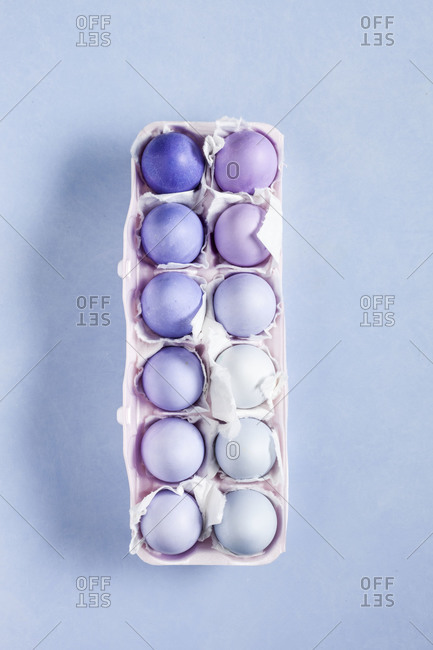 Different shades of dyed eggs in an egg holder