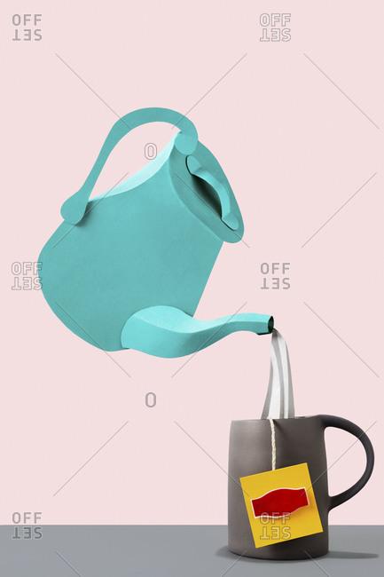 Pouring hot water into a tea mug