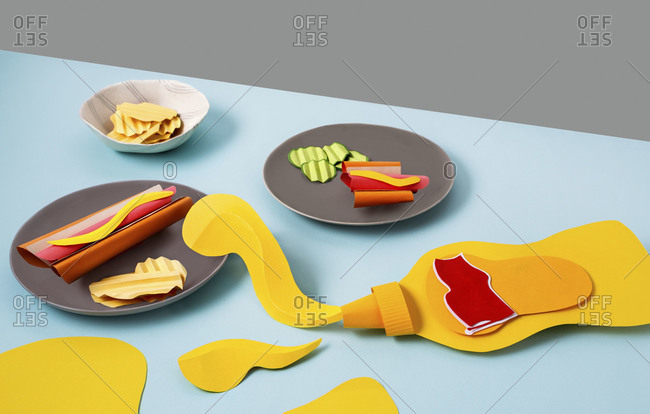French mustard and hot dogs on plates