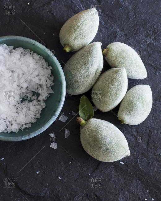 Still life of green almonds and salt