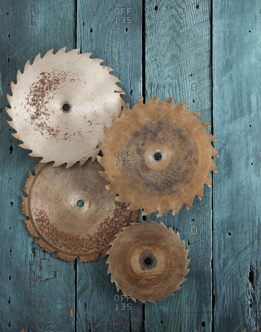 Saw blades on a wooden tabletop