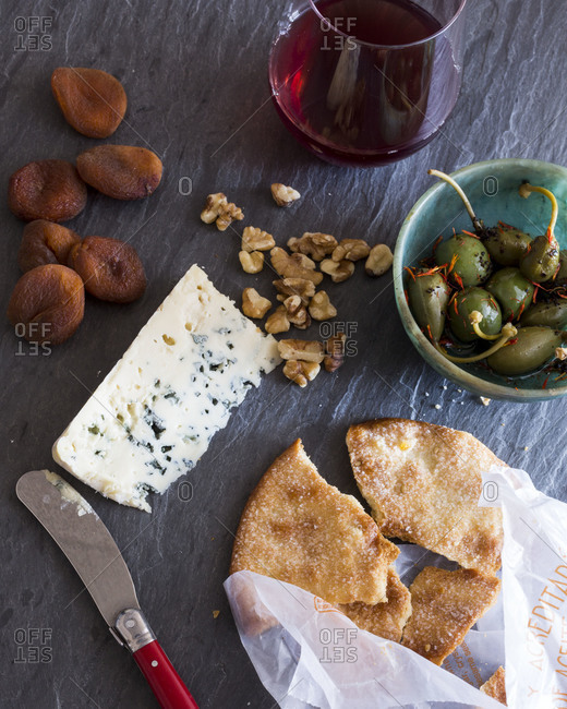 Bread and cheese served with olives