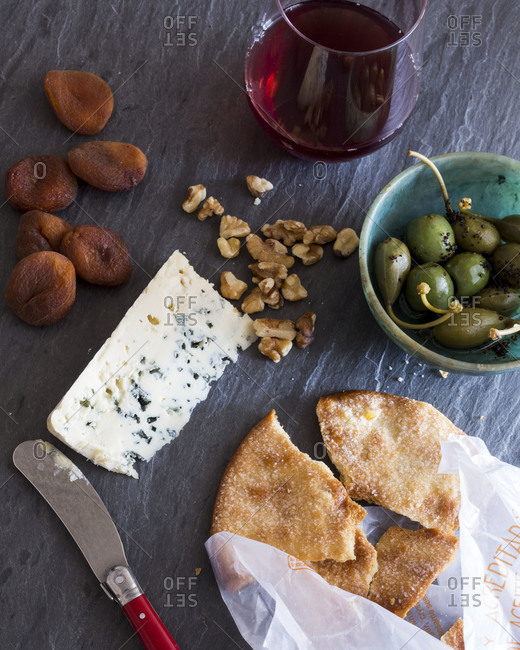 Bread served with cheese and olives