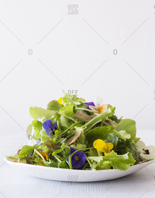 Spring salad served with edible flowers