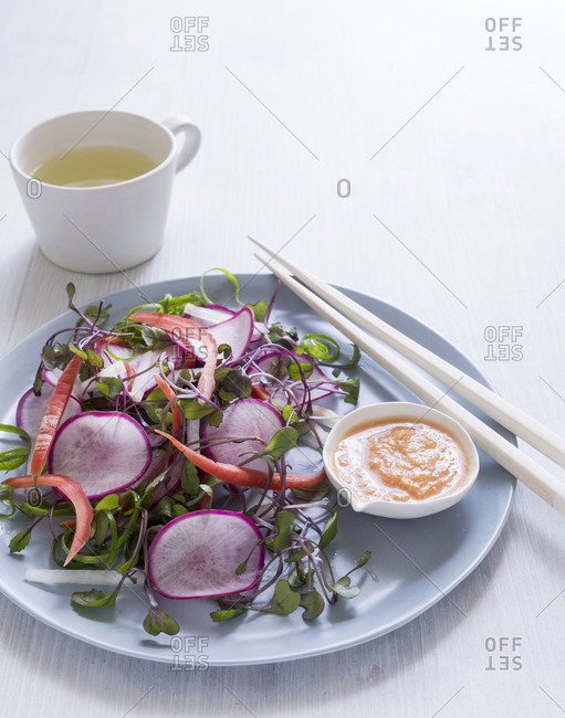 Spring salad with radishes served on a table