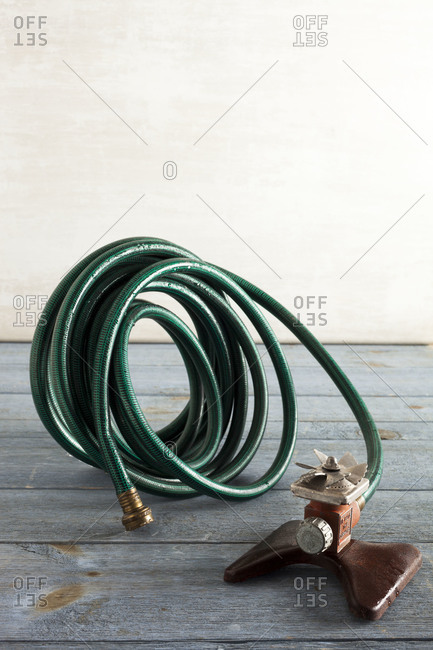 Still life of a coiled up sprinkler