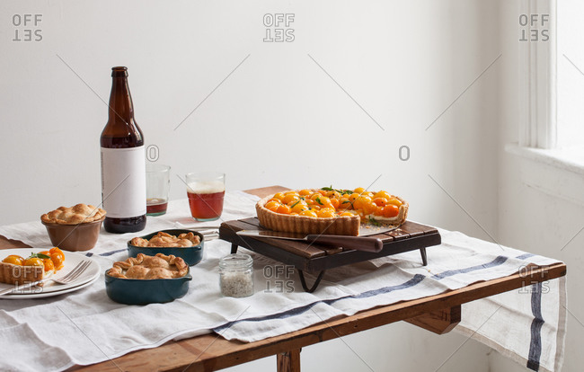 Tomato dishes served on a table with a bottle of beer
