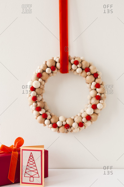 Christmas wreath with gifts and a card