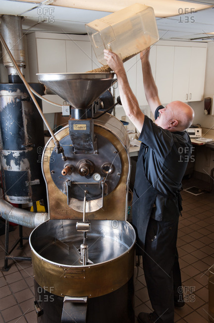 Reno, Nevada, USA - September 25, 2013: Man roasting coffee in a large brass coffee roaster