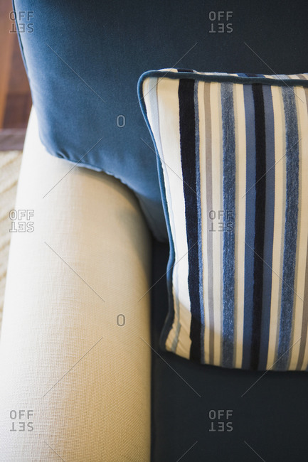Detail blue and white striped throw pillow on armchair