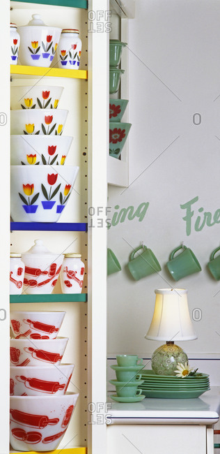 Patterened bowls and canisters in cupboard