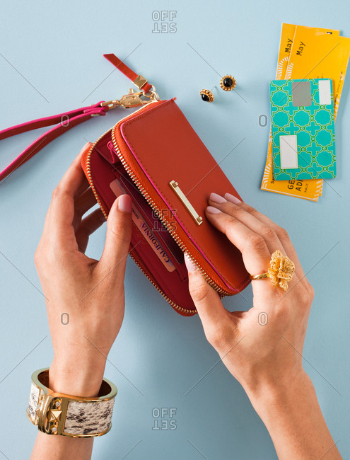 Woman taking things out of her pocket book