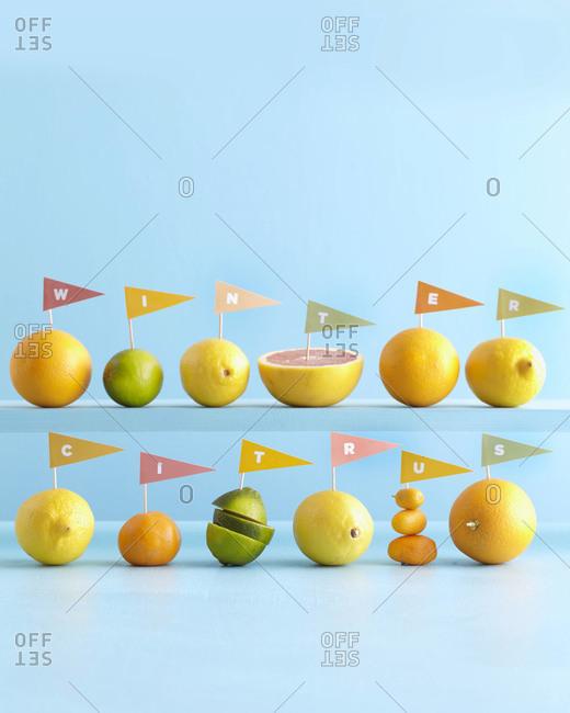 Citrus fruit with pendants spelling out message